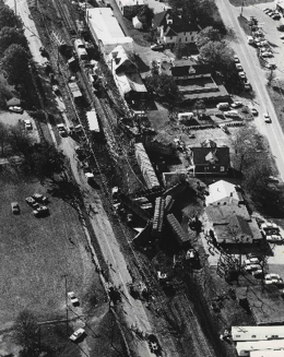 Crestwood Train Derailment, October 30, 1968. Aerial view showing wreckage of massive explosion of train cars carrying rocket propellant. A steel pipe came loose and fell between the cars and the track igniting the rocket propellant.