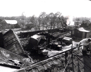 Crestwood Train Derailment, October 30, 1968. Roof repair has begun on one of the nearby buildings that was set on fire during the wreck.