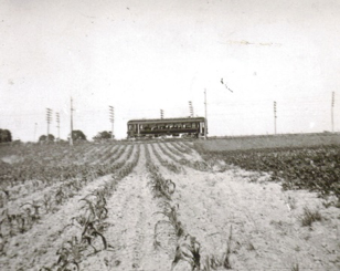 Louisville Interurban electric train car running along what is now Highway 146 outside of Crestwood passing the Klingenfus Farm (now South Oldham School Campus) circa 1920, heading toward La Grange. The Interurban line was extended from Crestwood to La Grange in 1907.