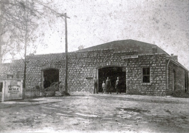 Moss & Gibson's Garage in Crestwood circa 1930's. With the introduction of the car, automotive services became a desirable business. Subsequently, this building held a car sales company and later a farm implements sales company. This building still remains today.